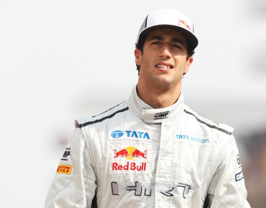 Daniel Ricciardo walks down the pit lane