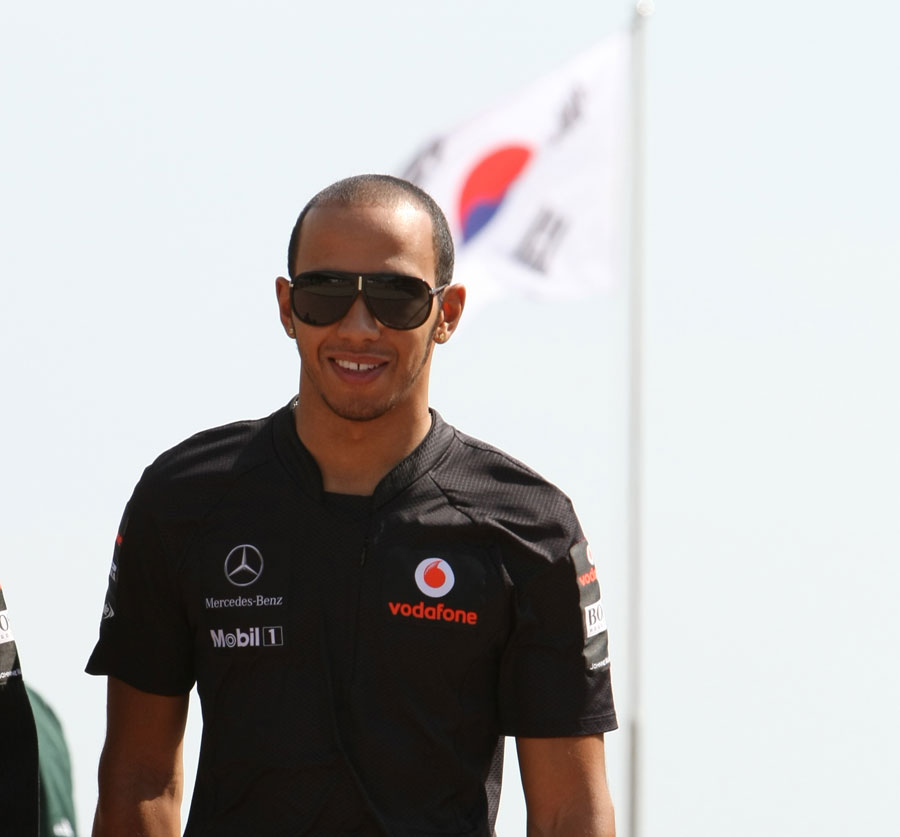 Lewis Hamilton arrives at the circuit ahead of the race