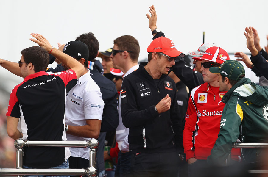 Jenson Button, Fernando Alonso and Jarno Trulli chat during the drivers' parade
