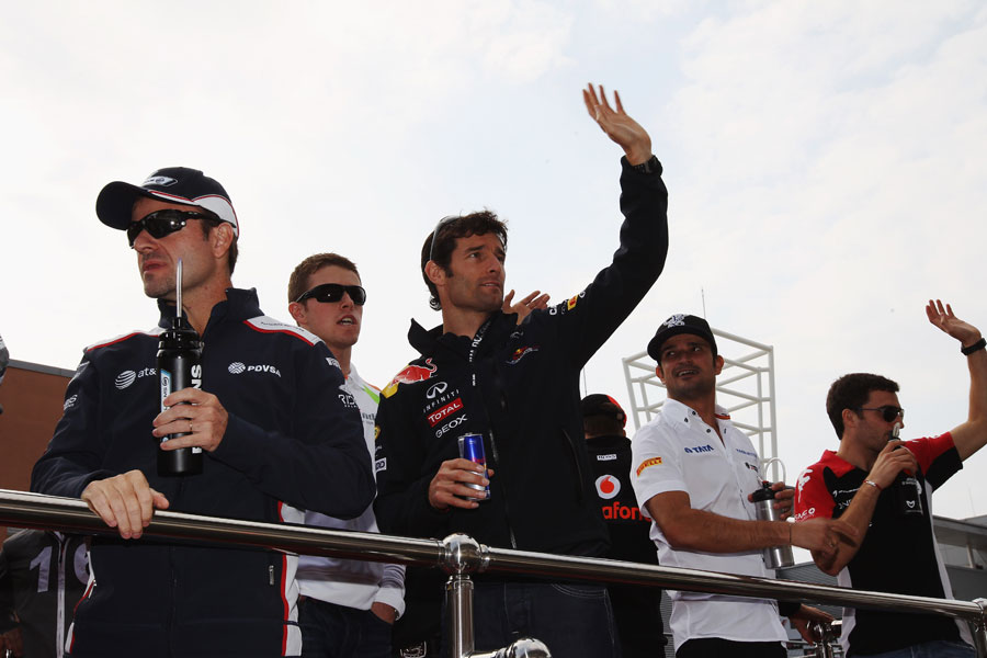 Drivers wave to the crowd on the driver parade