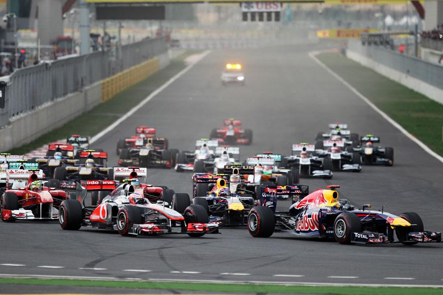 Sebastian Vettel holds off Jenson Button in to turn one