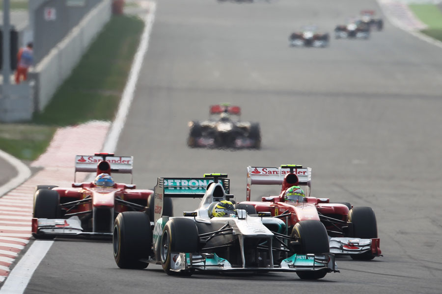 Nico Rosberg holds off Fernando Alonso and Felipe Massa