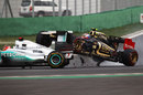 Vitaly Petrov ploughs in to the back of Michael Schumacher at turn three