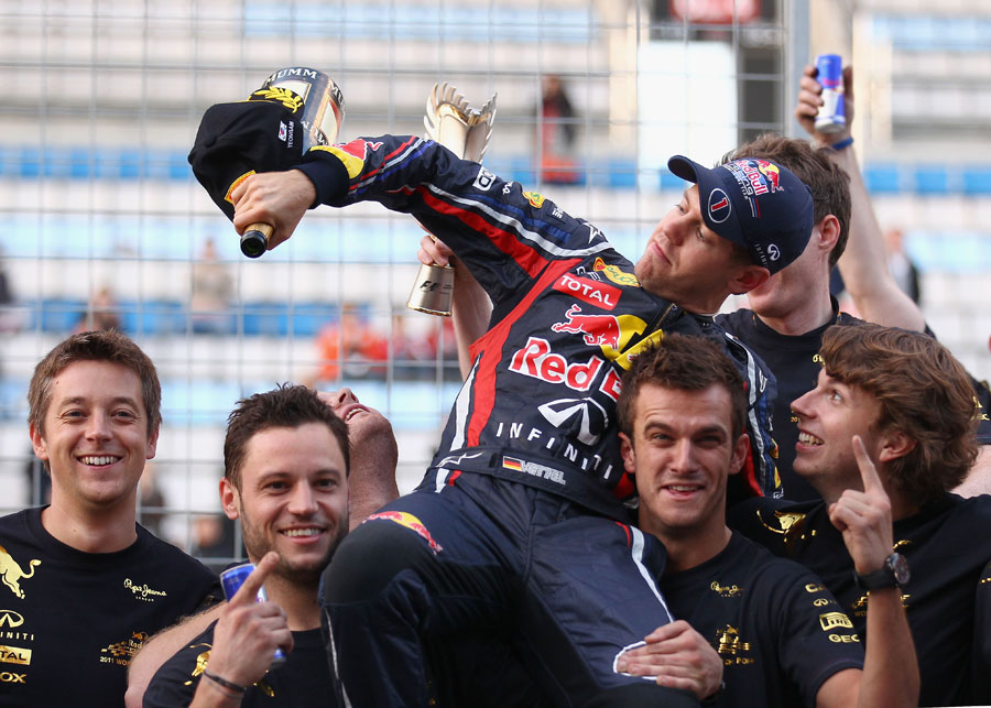 Sebastian Vettel celebrates with his Red Bull mechanics after securing the constructors' championship