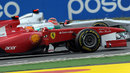 Fernando Alonso has to avoid Michael Schumacher after leaving the pit lane
