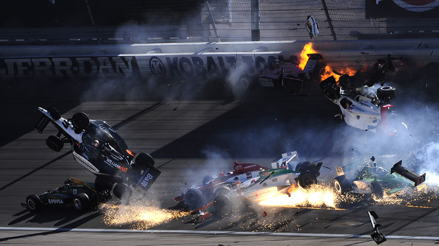 The car of Dan Wheldon (No. 77) flies in the air during a mass pile-up - he was seriously hurt and airlifted to hospital