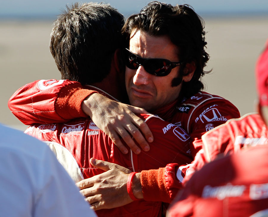Dario Franchitti hugs a crew member after driver Dan Wheldon was killed during the Las Vegas Indy 300