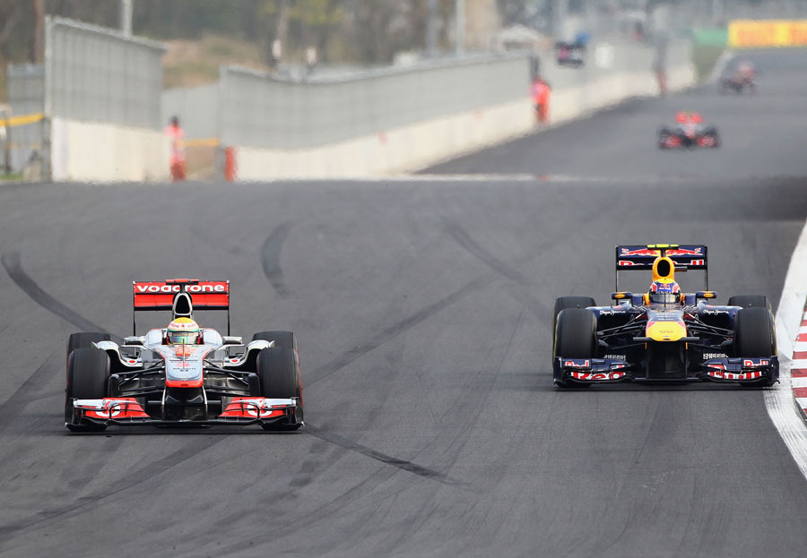Lewis Hamilton defends from Mark Webber in to turn three