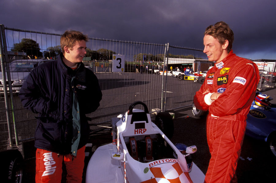 Dan Wheldon and Jenson Button chat before the Formula Ford festival