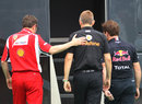 Stefano Domenicali, Martin Whitmarsh and Christian Horner head in to Bernie Ecclestone's motorhome