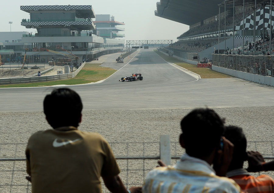 Neel Jani takes the Red Bull showcar around the track at the official unveiling of the new Buddh International Circuit