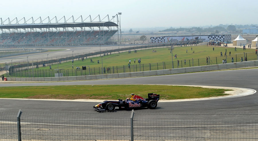 Neel Jani rounds turn three in the Red Bull showcar at the official unveiling of the new Buddh International Circuit