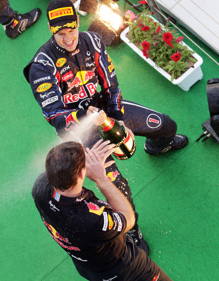 Sebastian Vettel sprays Christian Horner with champagne