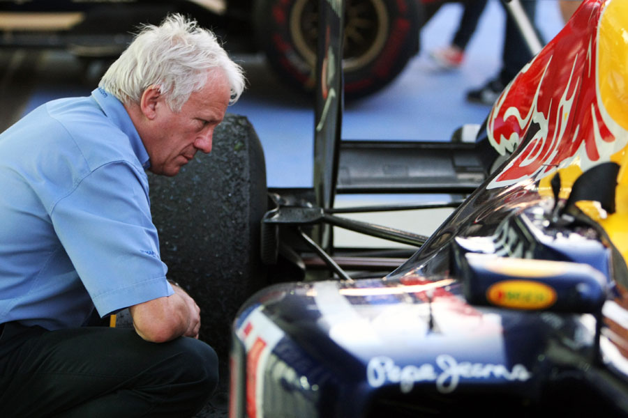 FIA race director Charlie Whiting takes a closer look at the rear of the Red Bull