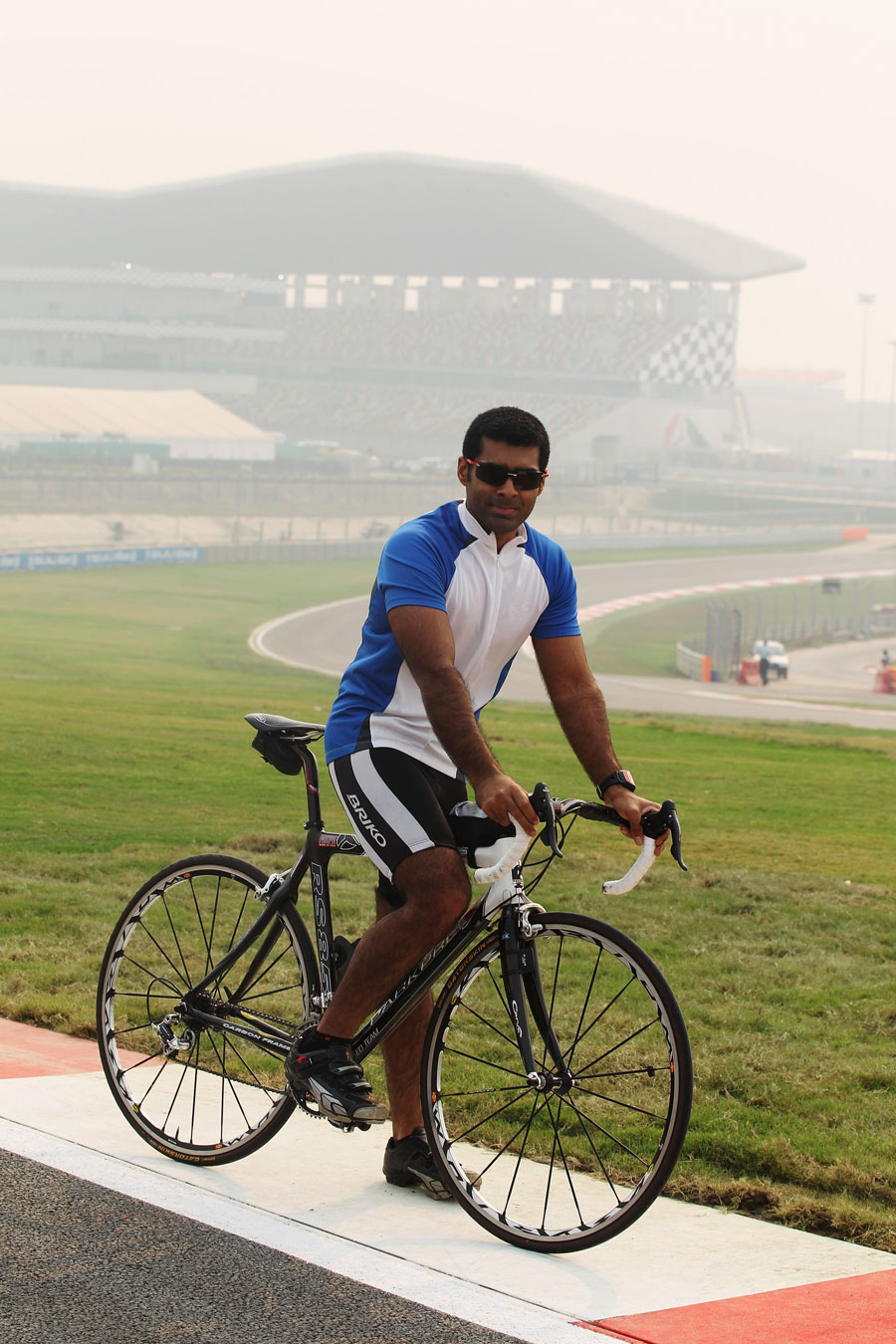 Karun Chandhok cycles the Buddh circuit