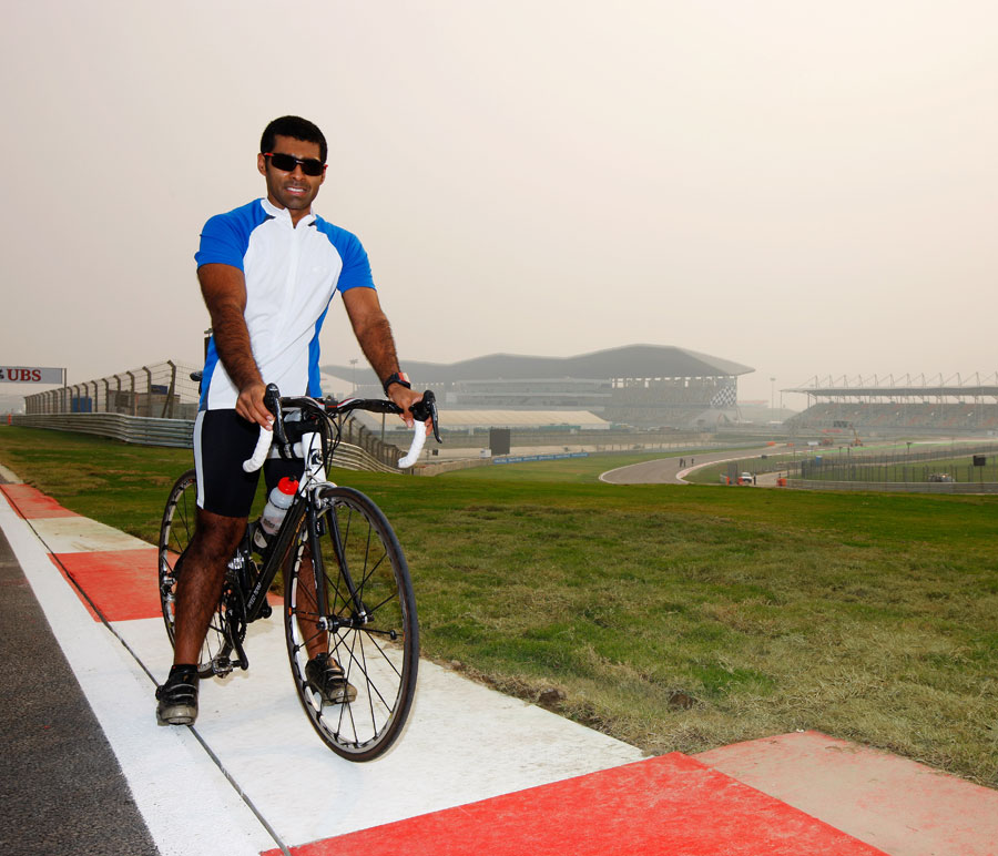 Karun Chandhok stops his bike on the Buddh circuit