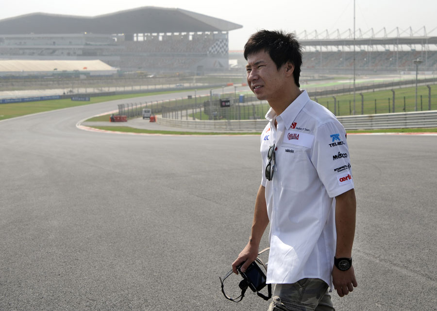 Kamui Kobayashi walks around the Buddh International Circuit
