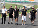 Bruno Senna walks the track with his race engineers