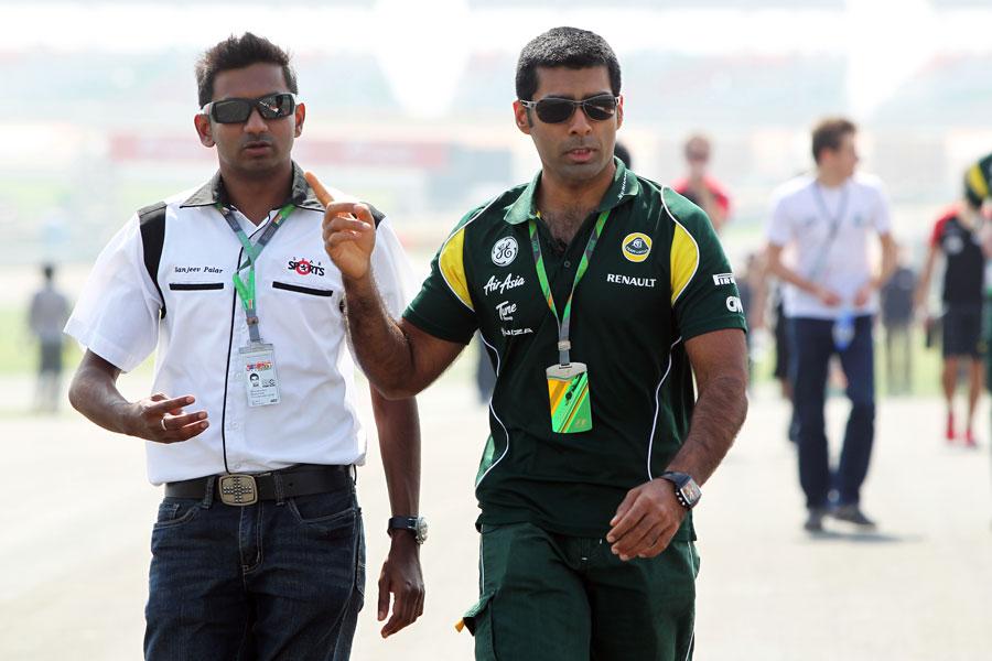 Lotus reserve driver Karun Chandhok  walks the track