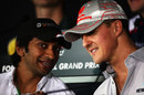 Indian driver Narain Karthikeyan talks to Michael Schumacher in Thursday's press conference