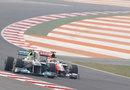 Nico Rosberg passes Narain Karthikeyan