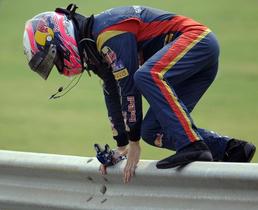 Jaime Alguersuari vaults the barrier