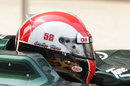 Jarno Trulli sporting a helmet in tribute to Marco Simoncelli