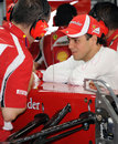 Felipe Massa chats with his mechanic