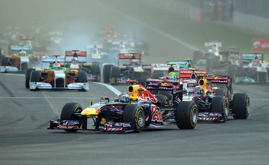Sebastian Vettel leads at the start