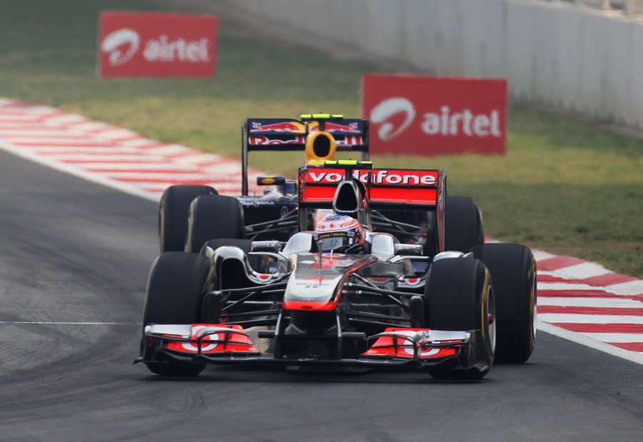 Mark Webber challenges Jenson Button