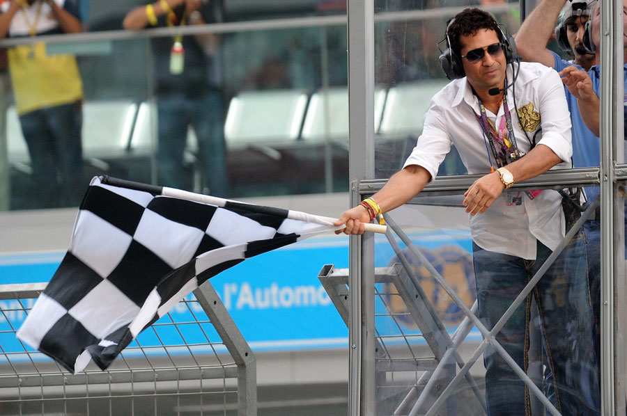 Sachin Tendulkar waves the chequered flag