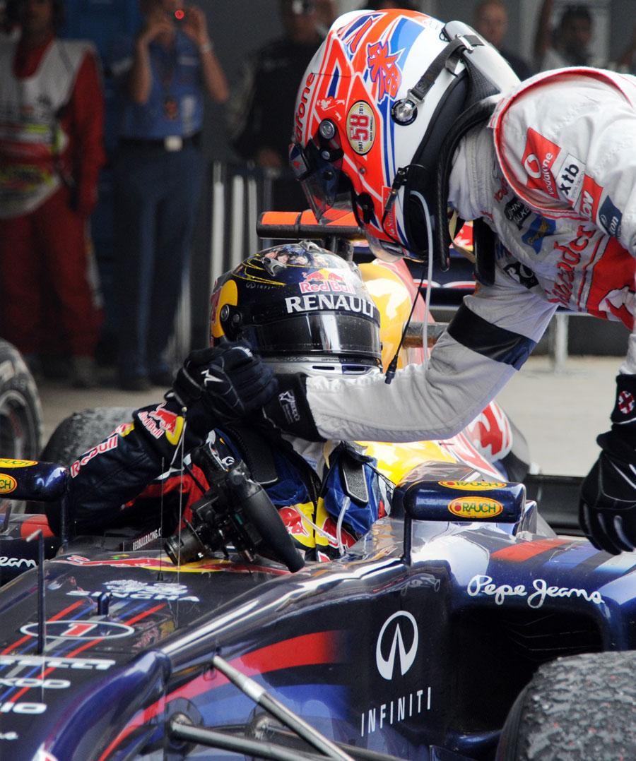 Jenson Button congratulates Sebastian Vettel