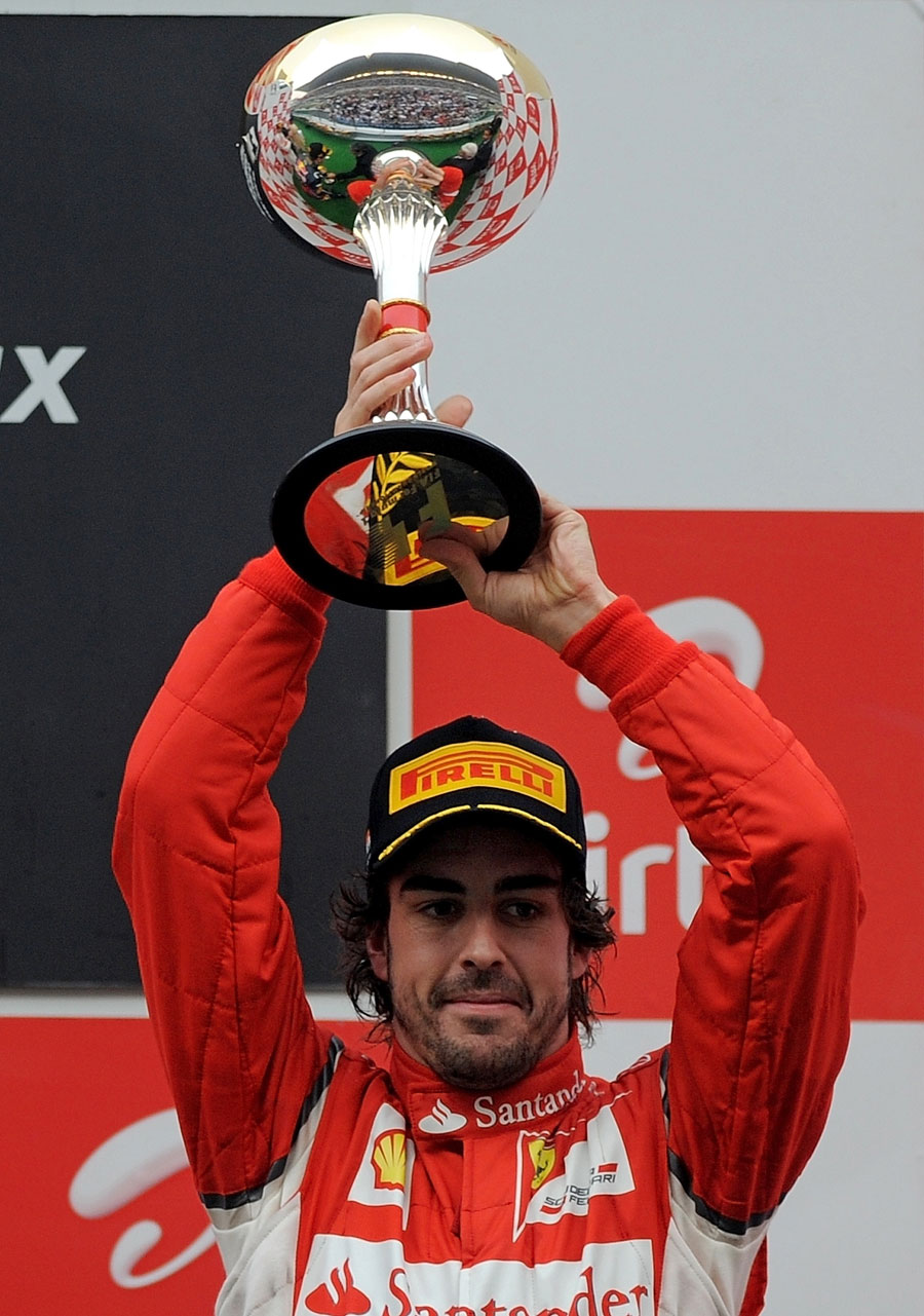 Fernando Alonso celebrates finishing third