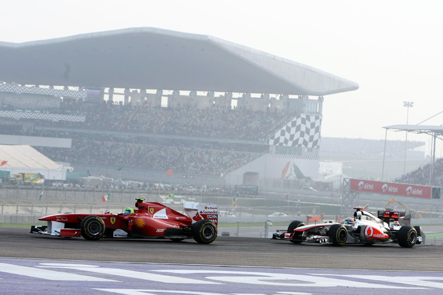 Felipe Massa leads Lewis Hamilton at turn three