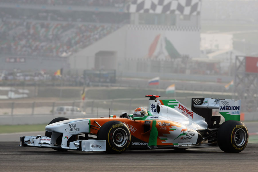 Adrian Sutil rounds turn three