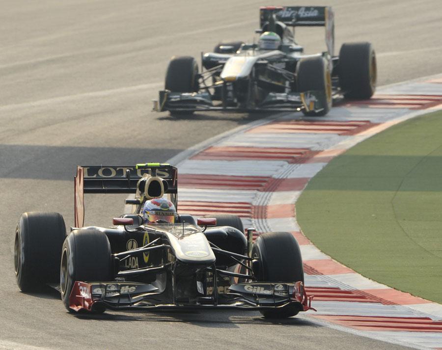 Vitaly Petrov heads Heikki Kovalainen