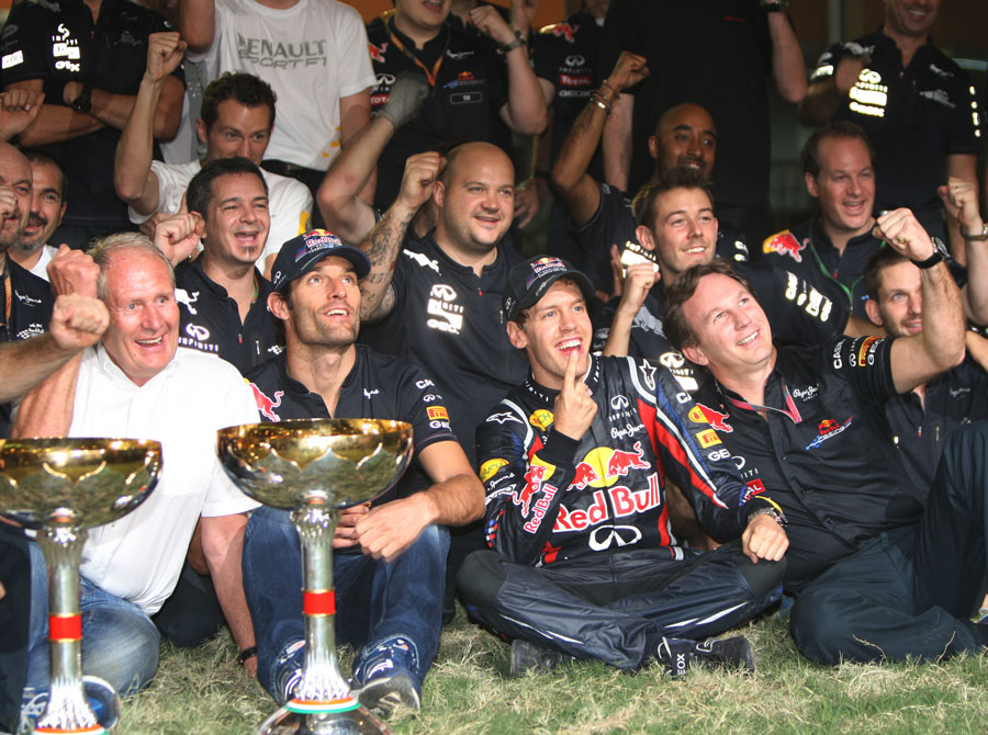 Sebastian Vettel celebrates with Mark Webber, Christian Horner and Helmut Marko