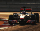 Jenson Button guides his McLaren to second place as the sun starts to set