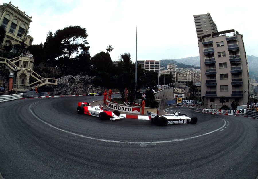 Race winner Ricardo Patrese leads John Watson's McLaren through the Loews hairpin