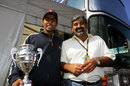 Karun Chandhok celebrates his victory with his father Vicky in the paddock