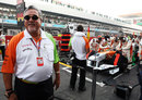 Vijay Mallya stands by Adrian Sutil's Force India on the grid
