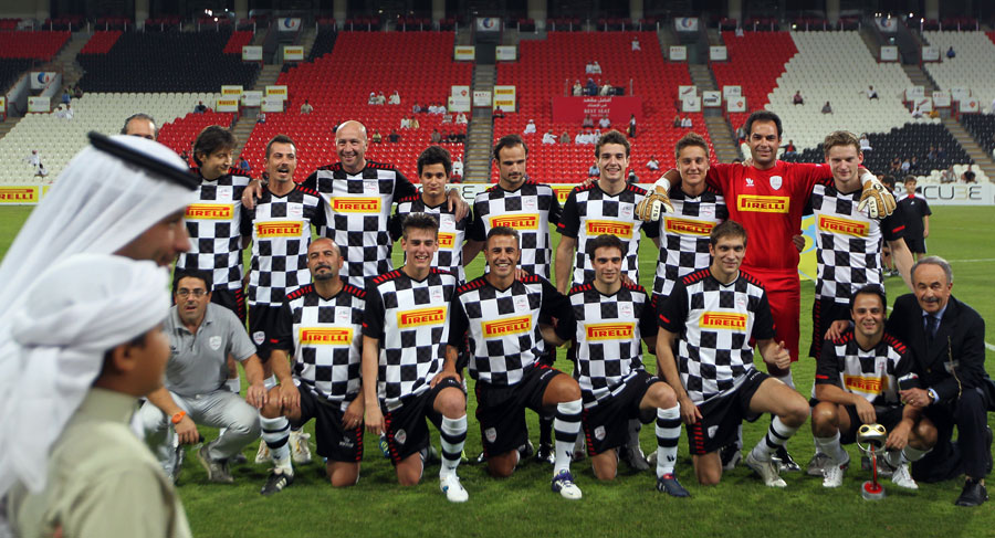 The drivers' team pose before a charity match against football stars