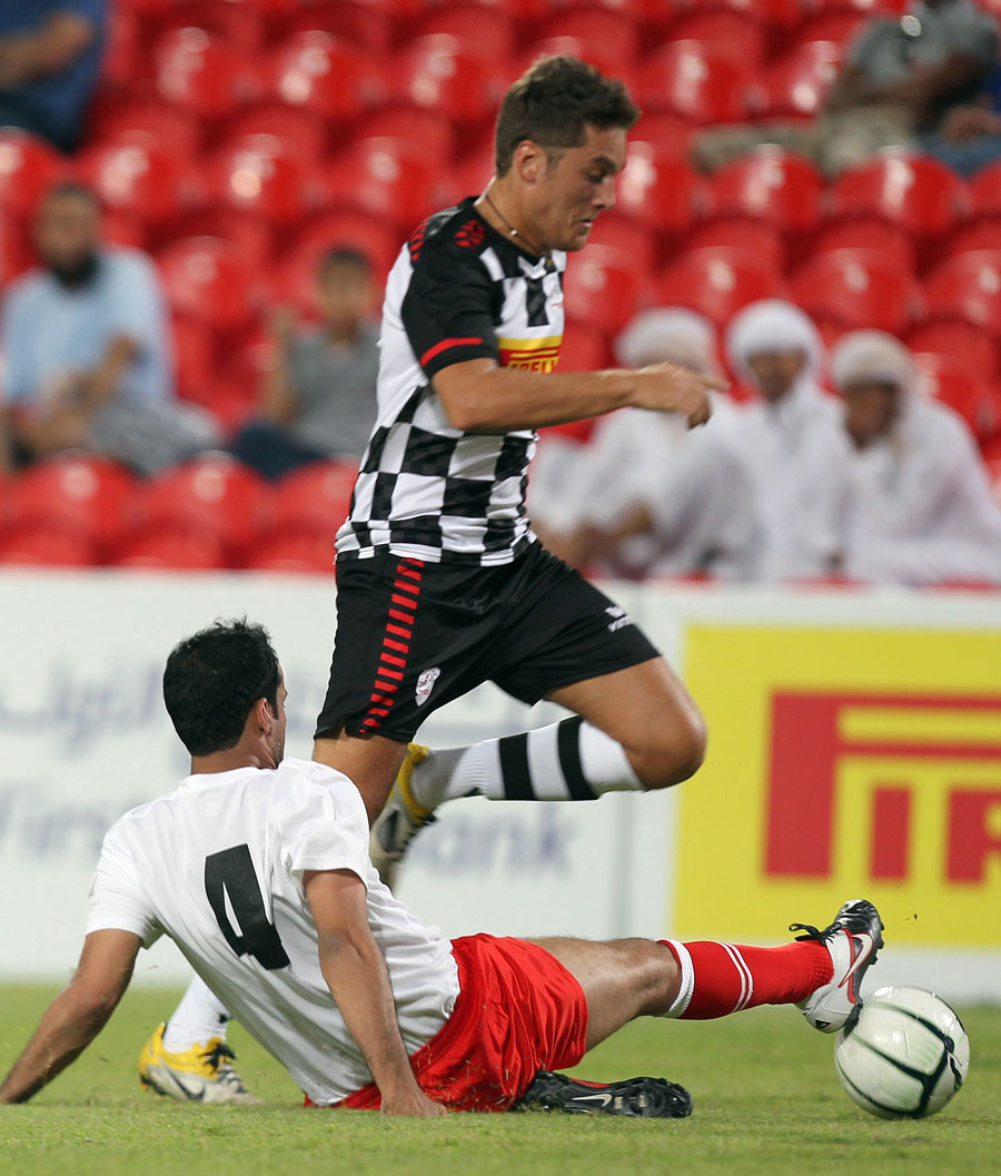 Stefano Coletti hurdles a tackle during a charity match