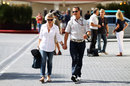 Michael Schumacher arrives at the circuit with his wife Corrina