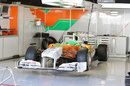 The Force India VJM04 sits in the garage
