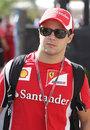 Felipe Massa walks through the paddock