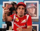 Fernando Alonso talks to the media