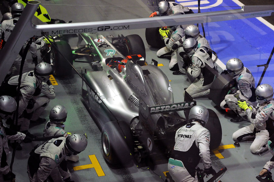 Michael Schumacher makes a pit stop