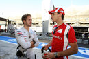 Sam Bird and Jules Bianchi chat in the pit lane
