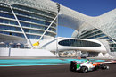 Paul di Resta aims for the apex of turn 18 below the Yas Hotel
